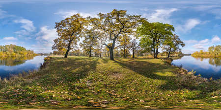 full seamless spherical hdri panorama 360 degrees angle view of beautiful landscape in oak grove with clumsy branches near river in gold autumn in equirectangular projection, ready VR AR content Imagens