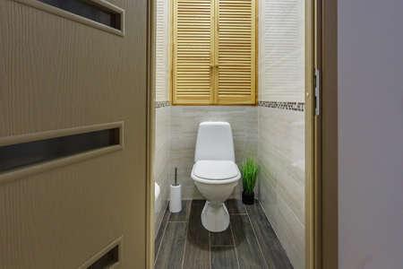 white ceramic toilet bowl in restroom