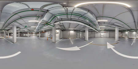 Full spherical hdri panorama 360 degrees in empty underground garage parking with columns and road markings in equirectangular projection, VR content