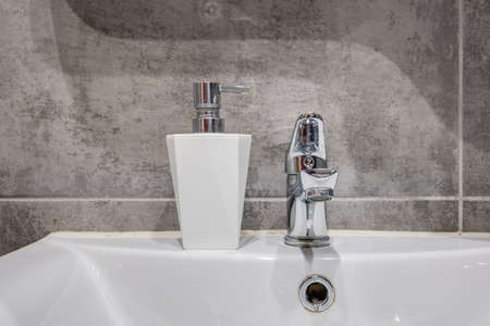 water tap sink with faucet in expensive bathroom
