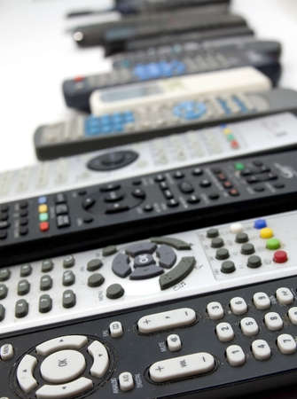 television remotes: Huge array of remote controls Stock Photo