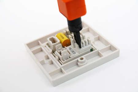 wall socket: Punch-down tool on RJ45 wall socket