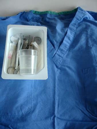 suture: Suture set on scrub top