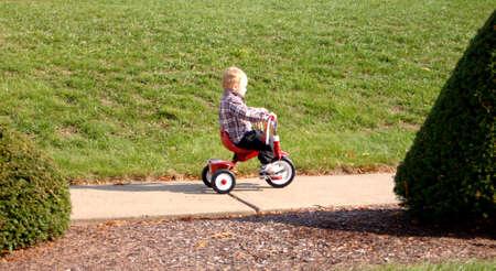 Toddler riding trike Stock Photo