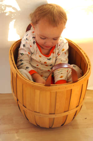 Toddler sitting in basket Stock Photo - 287911