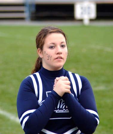 Cheerleader clapping hands