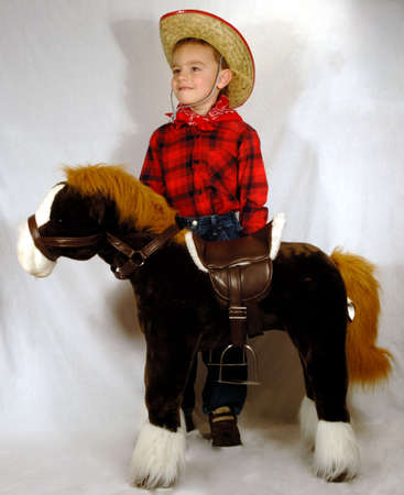 boy standing by toy horse