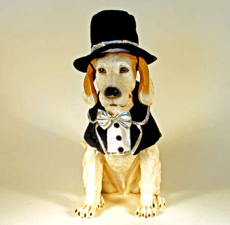 Dog statue dressed in tuxedo