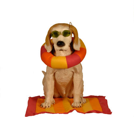Dog statue dressed with sunglasses ready for the beach and summer