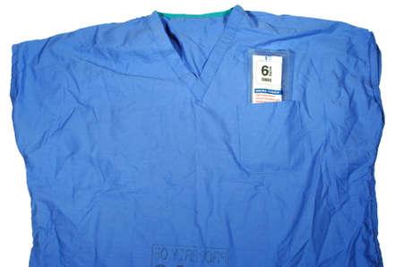 Blauw shirt met struikgewas pakje steriele handschoenen Stockfoto