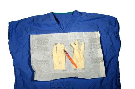 Scrub top met open latex handschoenen en Scapel