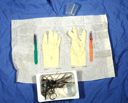 sterile: Scrub top as background for suture set with sterile gloves