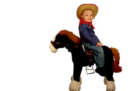 Young boy riding toy horse backwards photo