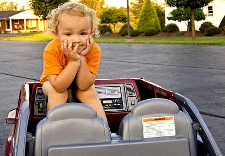 Young boy sitting backwards in car