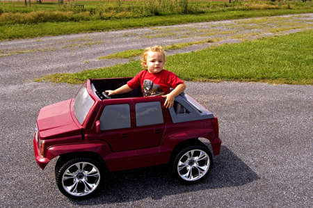 Young boy sitting in car Stock Photo