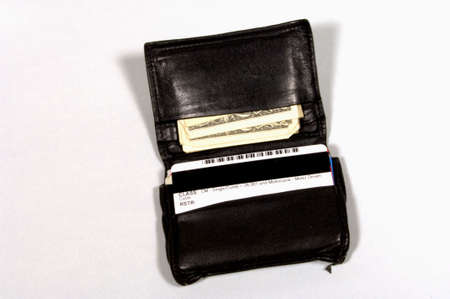 Open wallet with money and cards