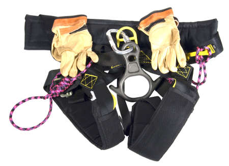 karabiner: Black rappelling harness with brown leather gloves Stock Photo