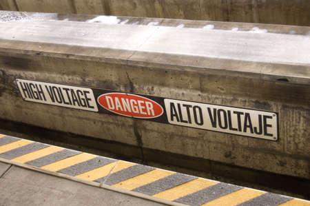 High voltage sign on rail