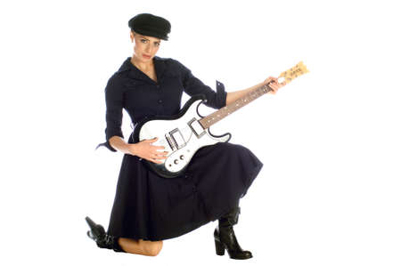 Beautiful blond dressed in black playing electric guitar photo