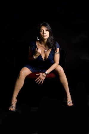stool: Beautiful model on stool leaning forward