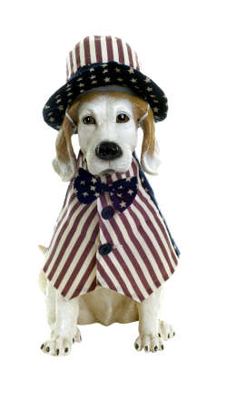 Dog statue dressed in patriotic vest, hat, and bow tie