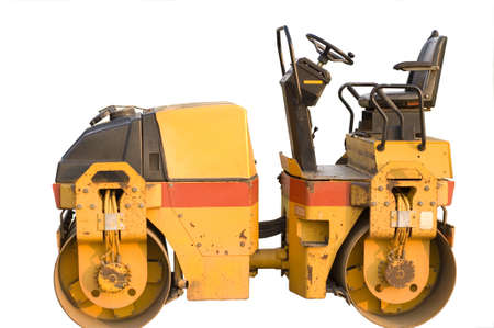 Heavy construction machine yellow roller against white background photo