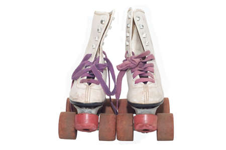 White leather retro roller skates isolated against white background photo