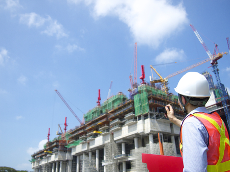Construction worker taking pictures Stock Photo