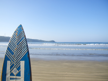 pristine coral reef: Blue surfing board with blue sky in Sri Lanka