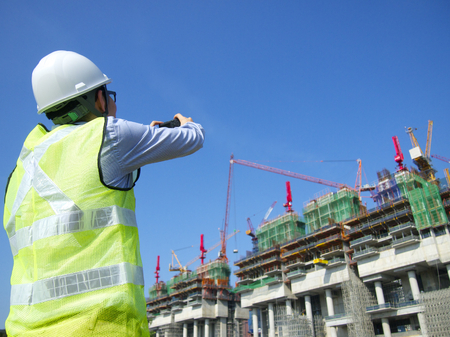 Construction worker taking photos with hands