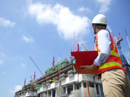 Construction worker with a red file Stock Photo