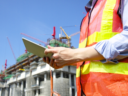 construction manager: Construction worker using tablet