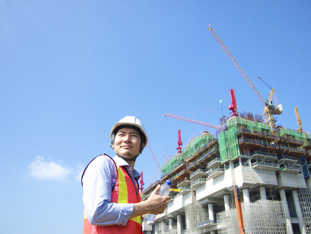 Construction worker holding a water