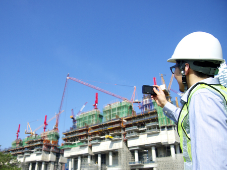 Construction worker taking photos