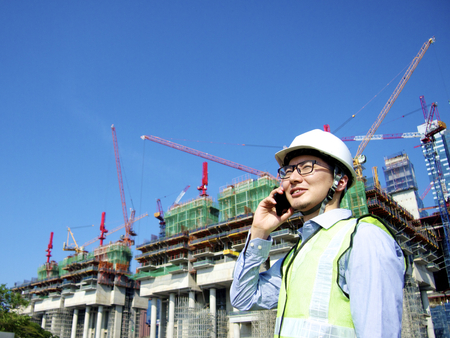 Construction worker talking on mobile phone Stock Photo