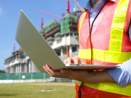 Construction worker with a pc