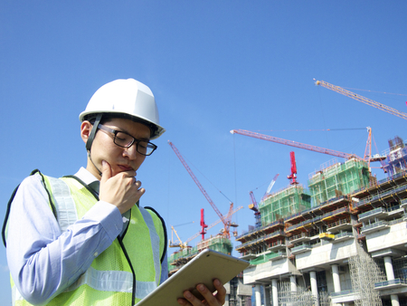 construction hat: Construction worker using tablet