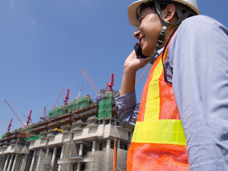 Construction worker using mobile phone Stock Photo