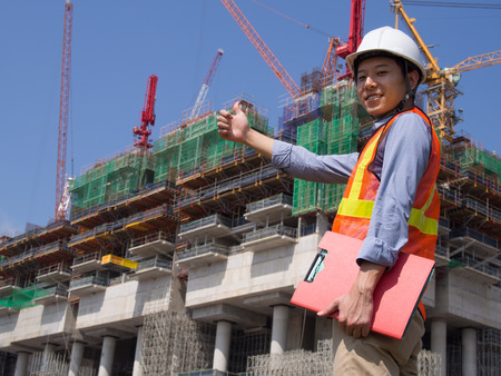 Construction worker holding a red file Stock Photo