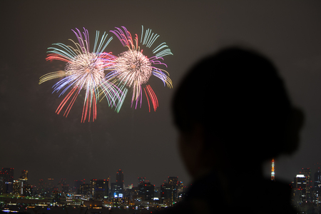 hanabi: A woman looking at fireworks in the night Stock Photo