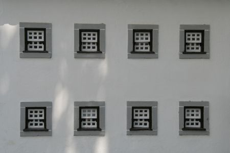 align: Eight traditional small windows align in a house Stock Photo