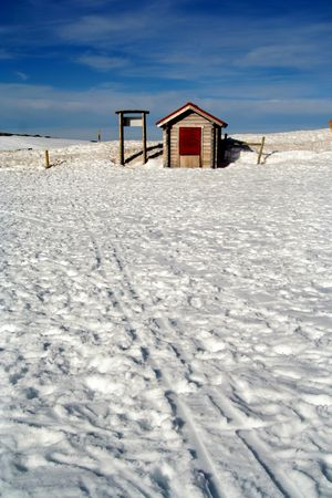 a litle snow house and the sky photo