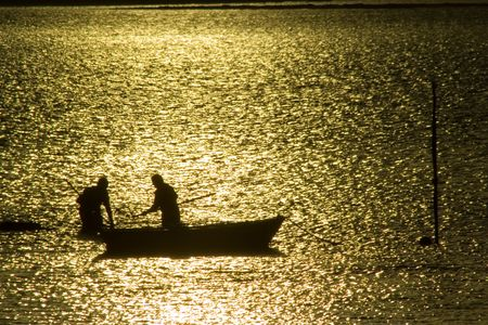 Two fisherman in water with back light Stock Photo - 776456
