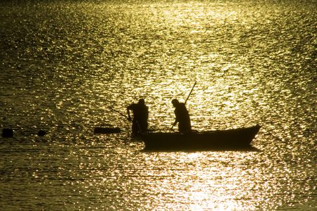 Two fisherman in water with back light Stock Photo - 776391