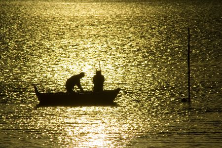 Two fisherman in water with back light Stock Photo - 776449