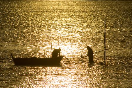 Two fisherman in water with back light Stock Photo - 776452