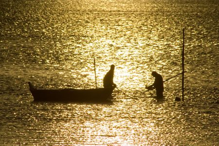 Two fisherman in water with back light Stock Photo - 776453