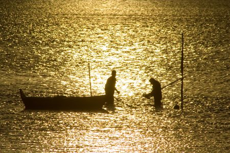 Two fisherman in water with back light Stock Photo - 776454