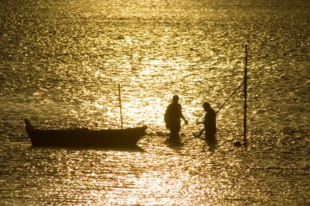 Two fisherman in water with back light Stock Photo - 776447