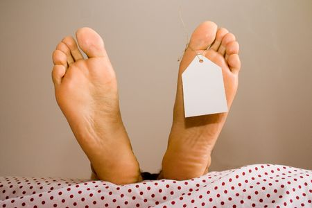 dead foots with a white tag in a bed Stock Photo